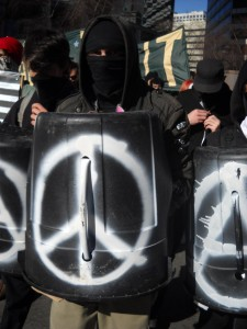 cu-protester-with-peace-shield